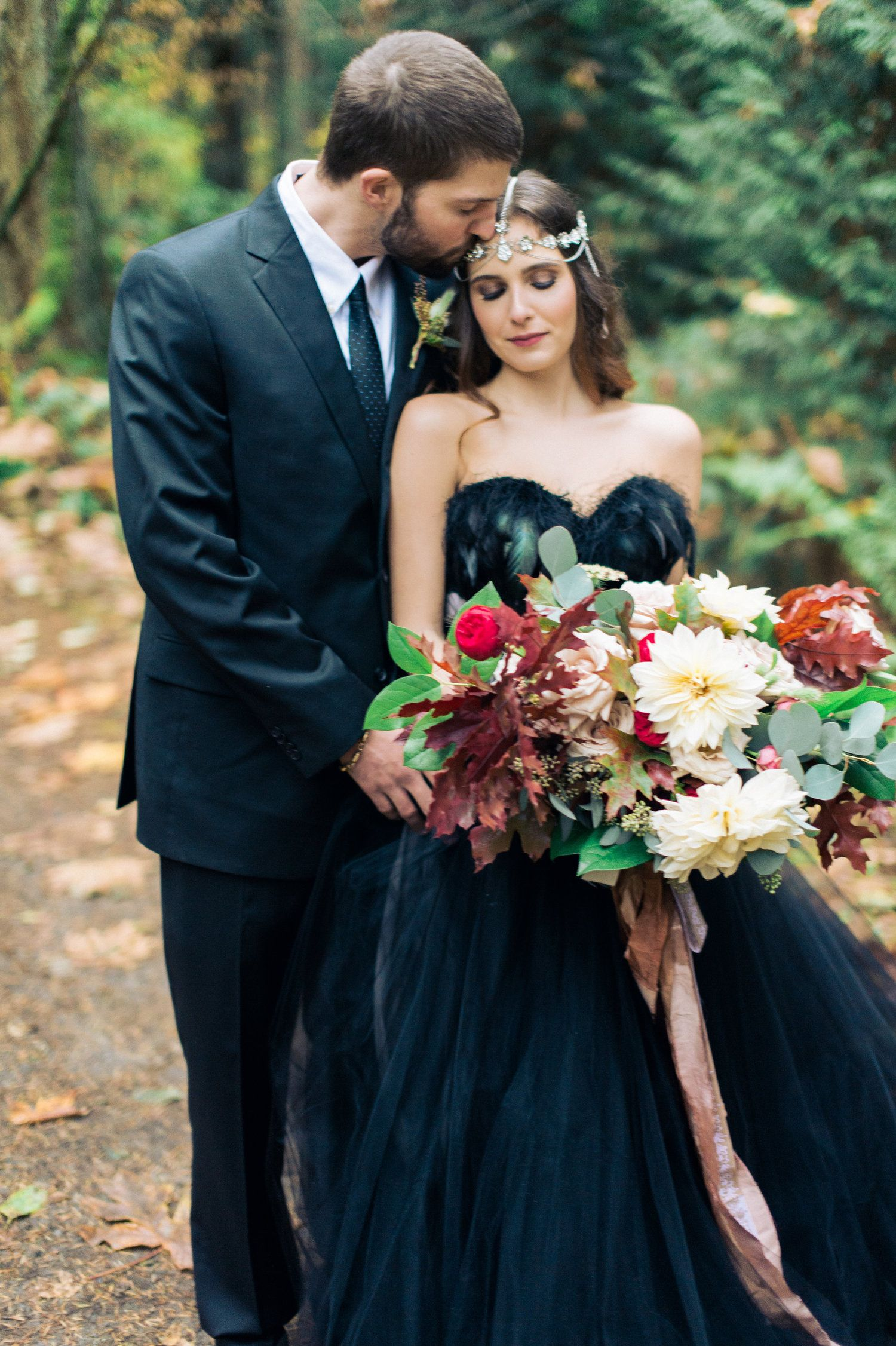 Black Wedding Dress by Clare La Faye. Photo: CJK visuals. Flowers ...