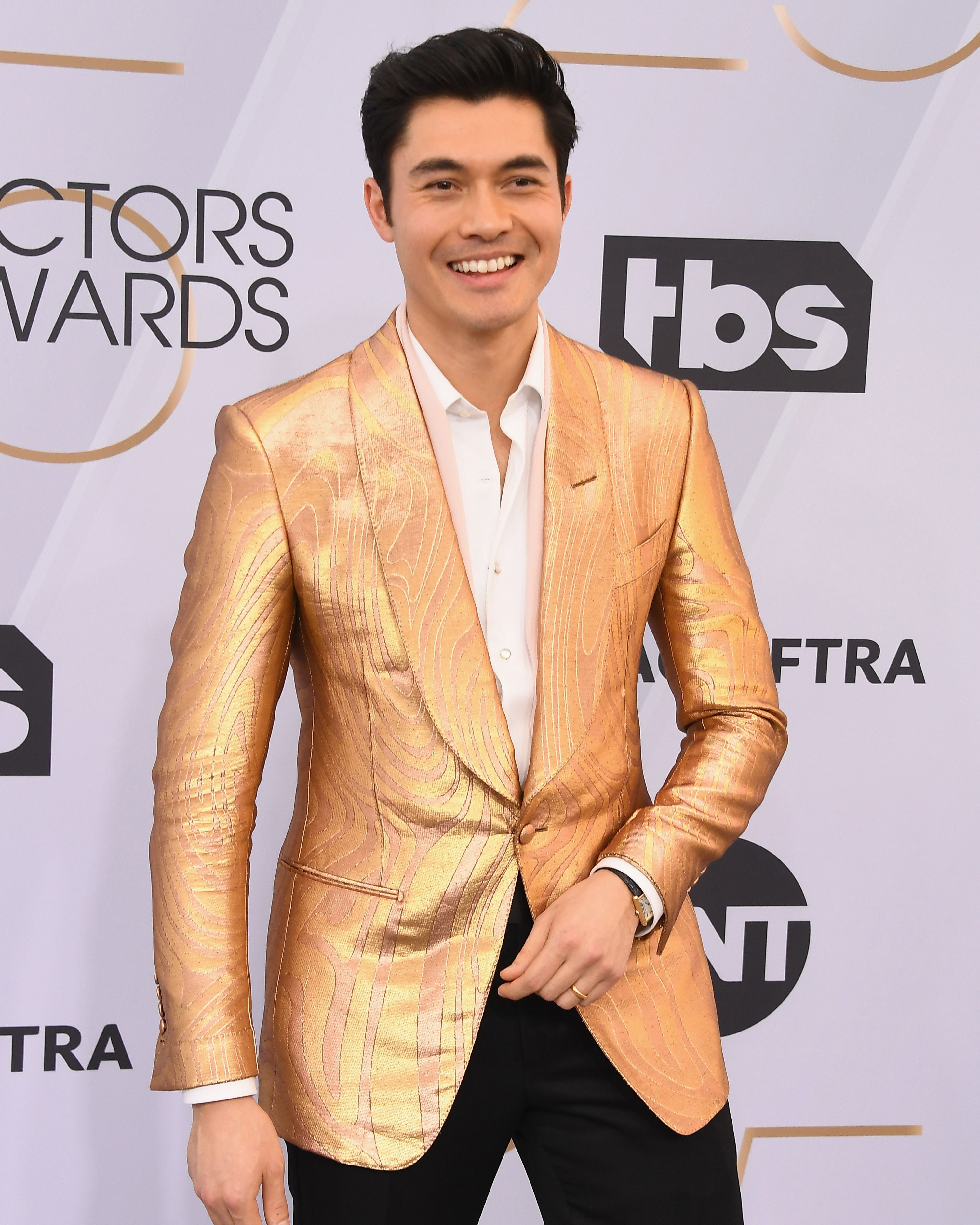 f0c29114fa Henry Golding wore a gold TOM FORD Atticus jacquard cocktail jacket ...
