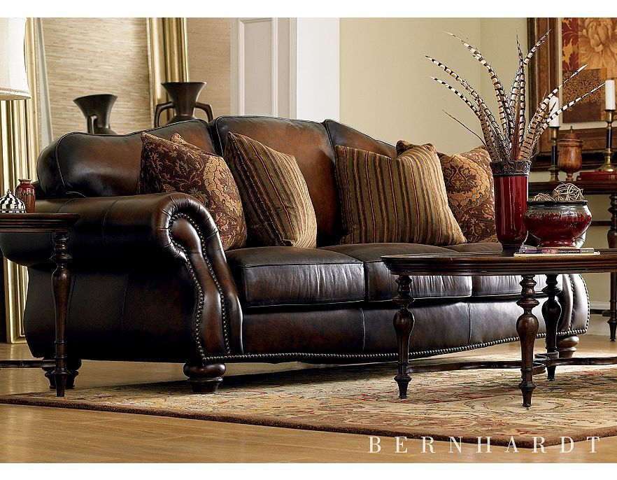 Design An Elegant Western Living Room With Grand Castleton Sofa A Camelback Silhouette And Antique Gold Nailhead Trim