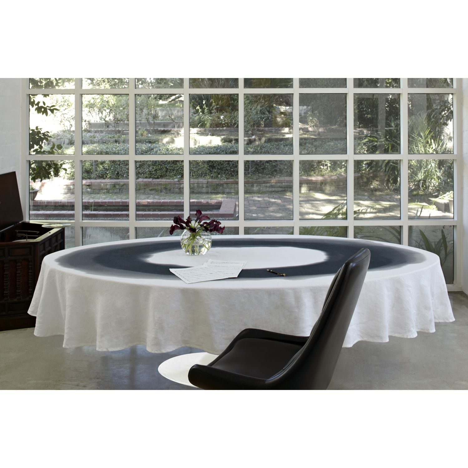Huddleson Linens Black and White Oval Moreton Tablecloth on a