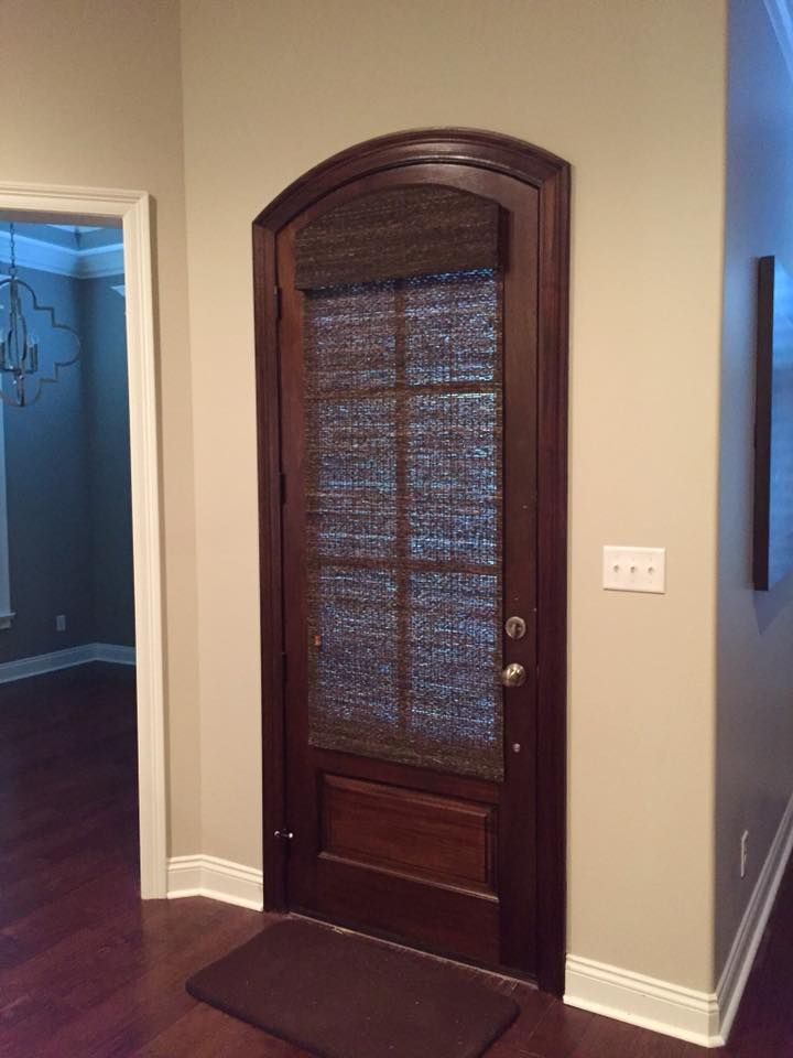 Need A Little Privacy For Your Door This Beautiful Arched Stained Door Is Covered With Our Woven Wood Sh Arched Entry Doors Door Shades Arched Exterior Doors