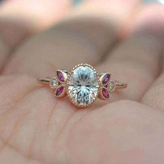 Vintage inspired engagement ring with an oval Mois