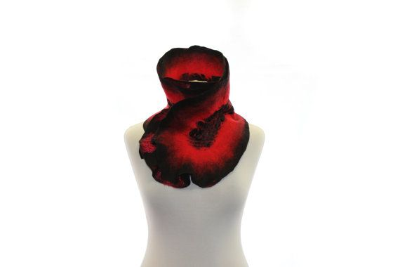 This stunning scarf was hand felted from fine merino wool on the silk. This scarf made in wet felting technique. Two side with a pattern from wool,