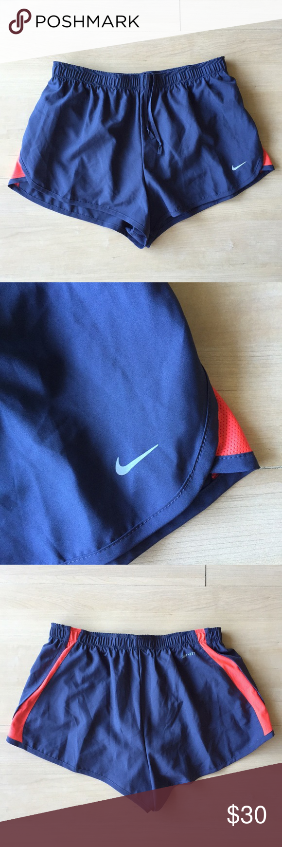 Nike Running Shorts | Navy Red | M Used couple of times. Non-stretchy navy material with red mesh insets, with navy underwear liner. Drawstring ties in front, open pocket right back on the liner. 100% polyester. Approximately 11 inch length at middle front of thigh. Machine wash cold, tumble dry low. Smoke-free/pet free home, no trades. Nike Shorts