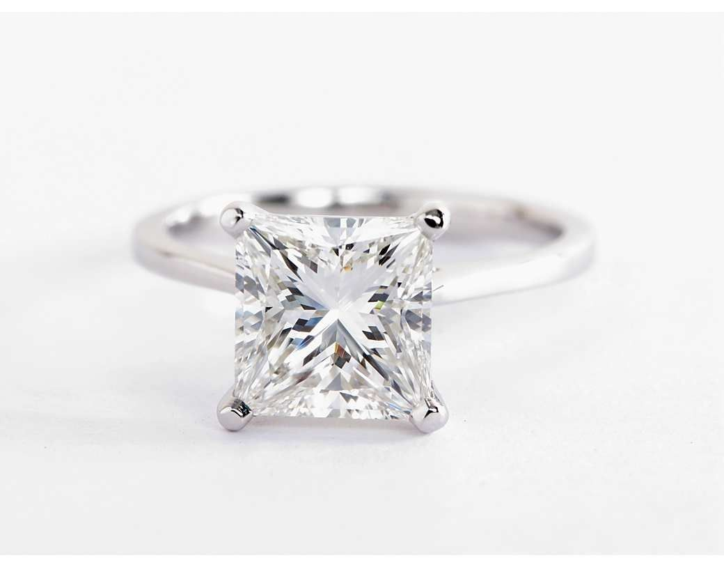 Petite cathedral solitaire engagement ring in platinum solitaire