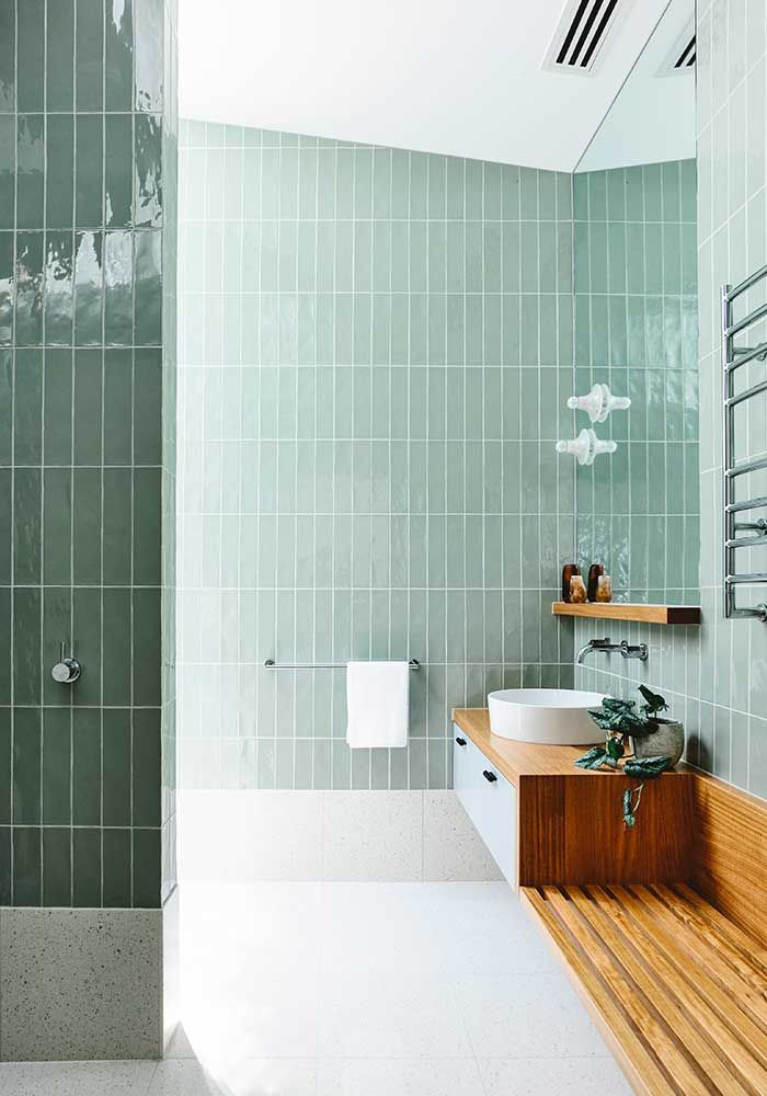 eat architects have used a combination of terrazzo flooring and mute olive wall tiles in this - Bathroom Tiles Combination
