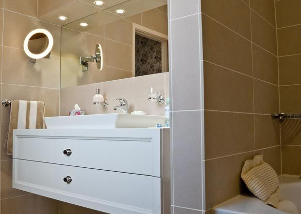 Luxury This beautiful ensuite features the Villeroy u Boch La Belle vanity unit offset against their cr me
