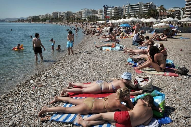 people on beaches in greece