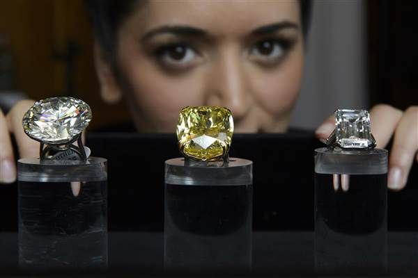 Sotheby's  - $16.3 million for the 100.09-carat 'The Graff Vivid Yellow Diamond' ring (center). Martial Trezzini / AP It said that the auction, featuring two diamonds over 100 carats, drew buyers from more than 30 countries.  The second huge diamond, at 103.46 carats, is part of a Graff diamond ring that sold for $4.9 million.