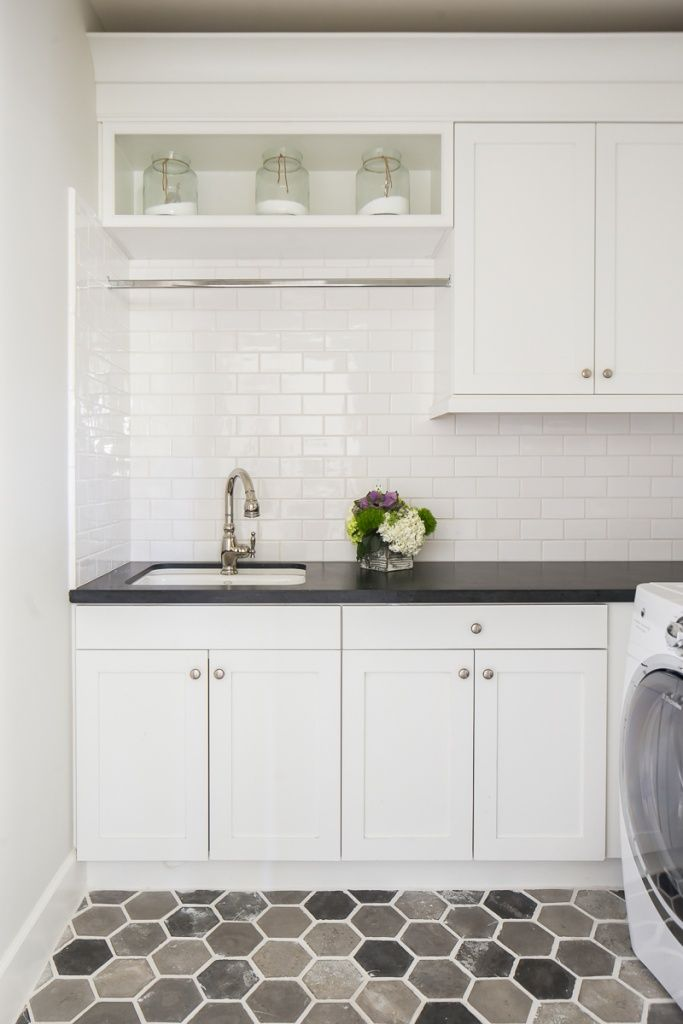 Hexagon Floor Tile Truly Pops Against These Fresh White Cabinets White Subway Tile Backsplash Des Small Laundry Rooms Laundry Room Design Laundry Room Tile