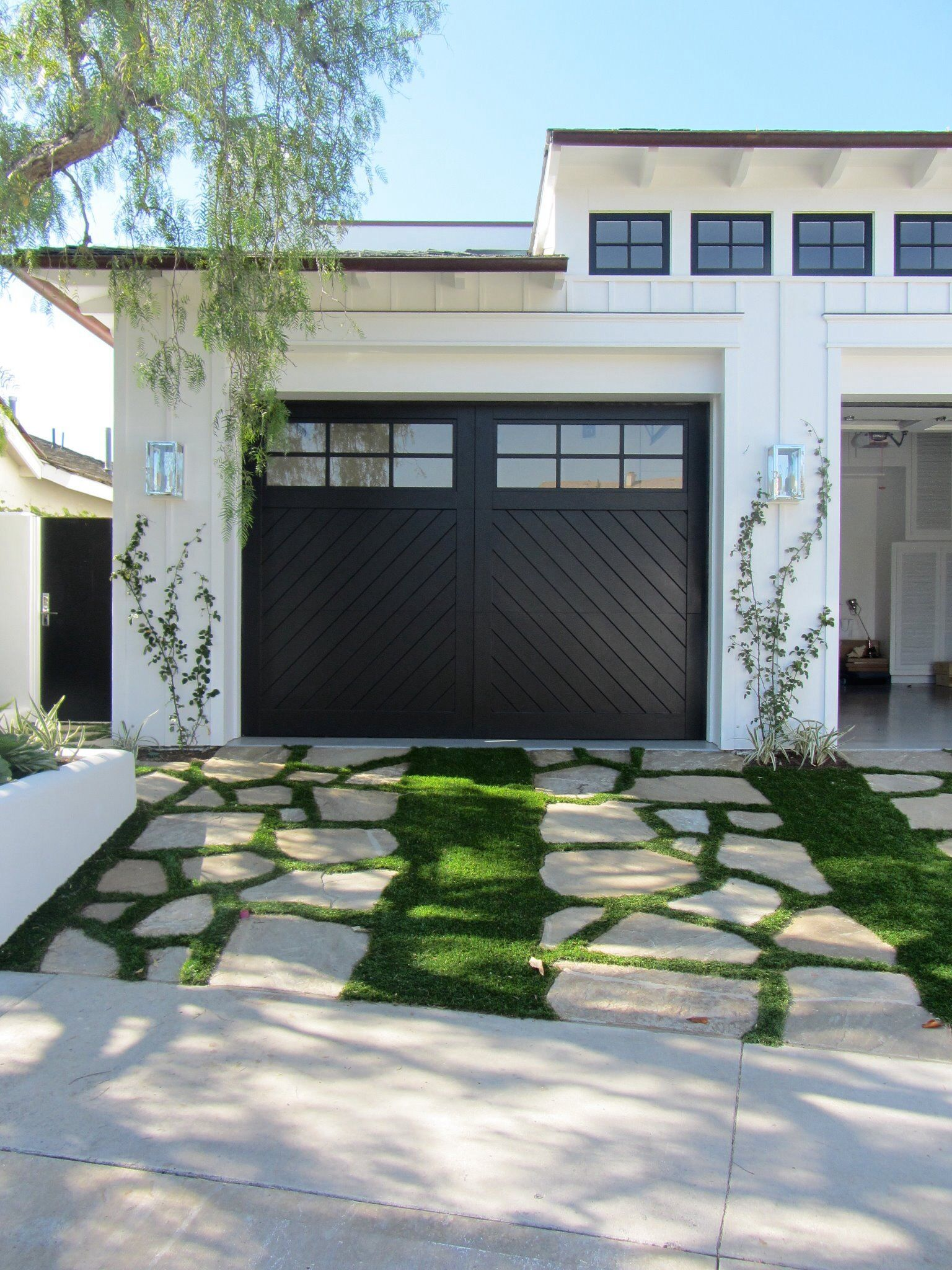 Garage door windows that open  Synthetic turf with flag stone llywoodgardendesign