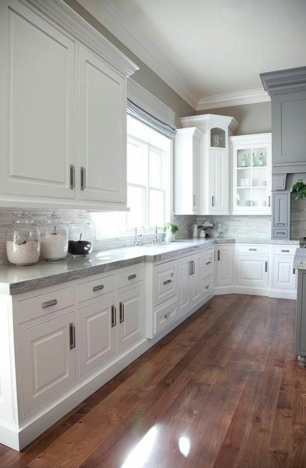 - White Cabinets, Grey Counter Tops, Light Grey Back Splash, Soft