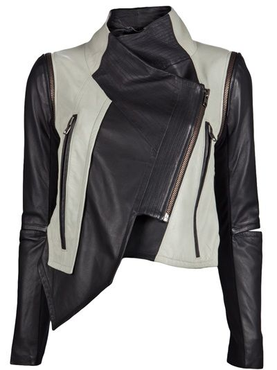 Color block jacket in optic and jet from Yigal Azrouel. This leather motorcycle jacket features a funnel collar with snap button fastening, front off-set exposed zipper closure, two front zipper pockets, and asymmetric front hem. Has zip-off sleeves with elbow cut-out and rib-knit panel, and curved side slits at hem.