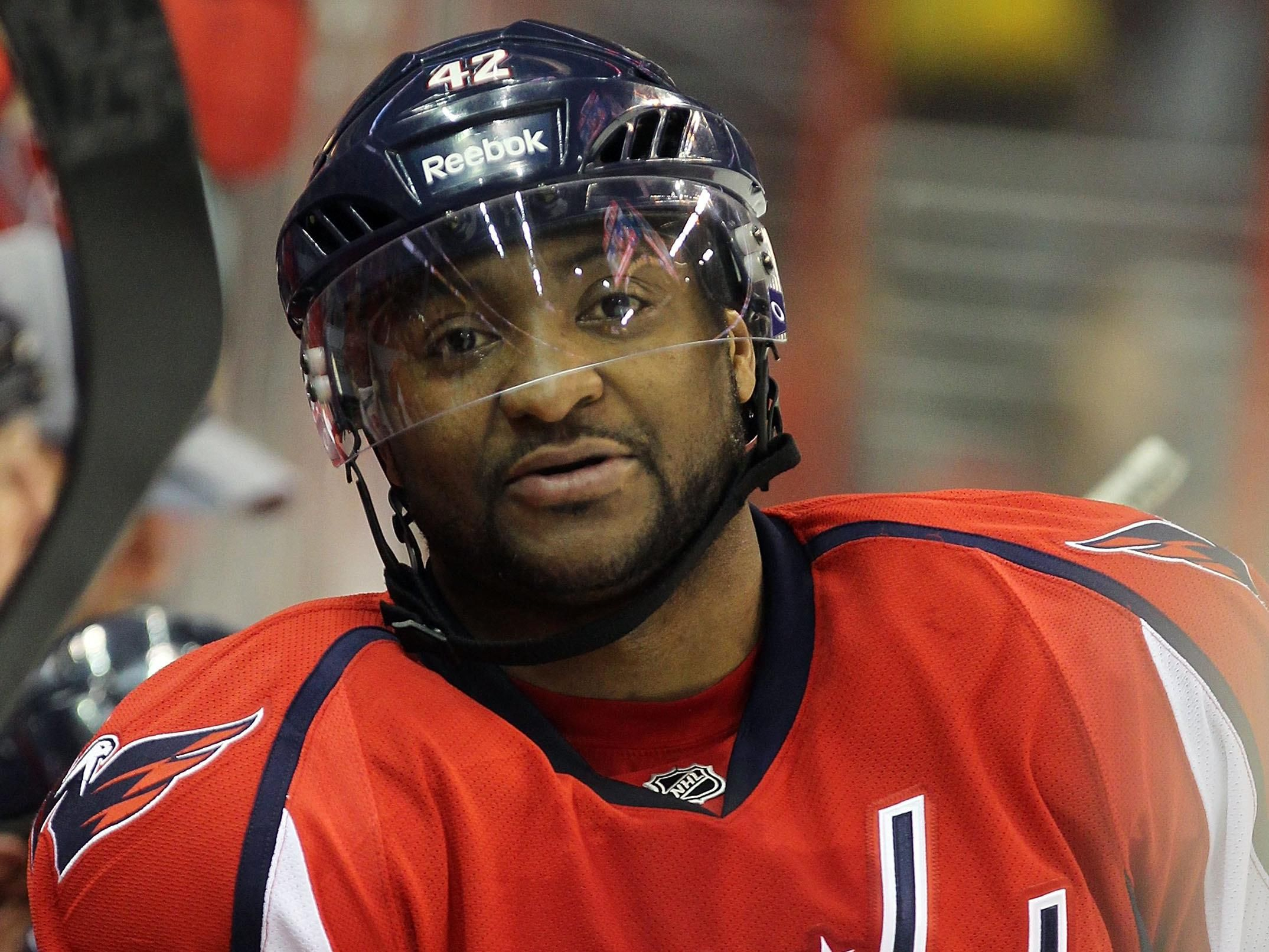 5b8aba0a5af (AP) - Washington Capitals players tapped the ice with sticks when Joel  Ward skated onto the rink for practice Friday