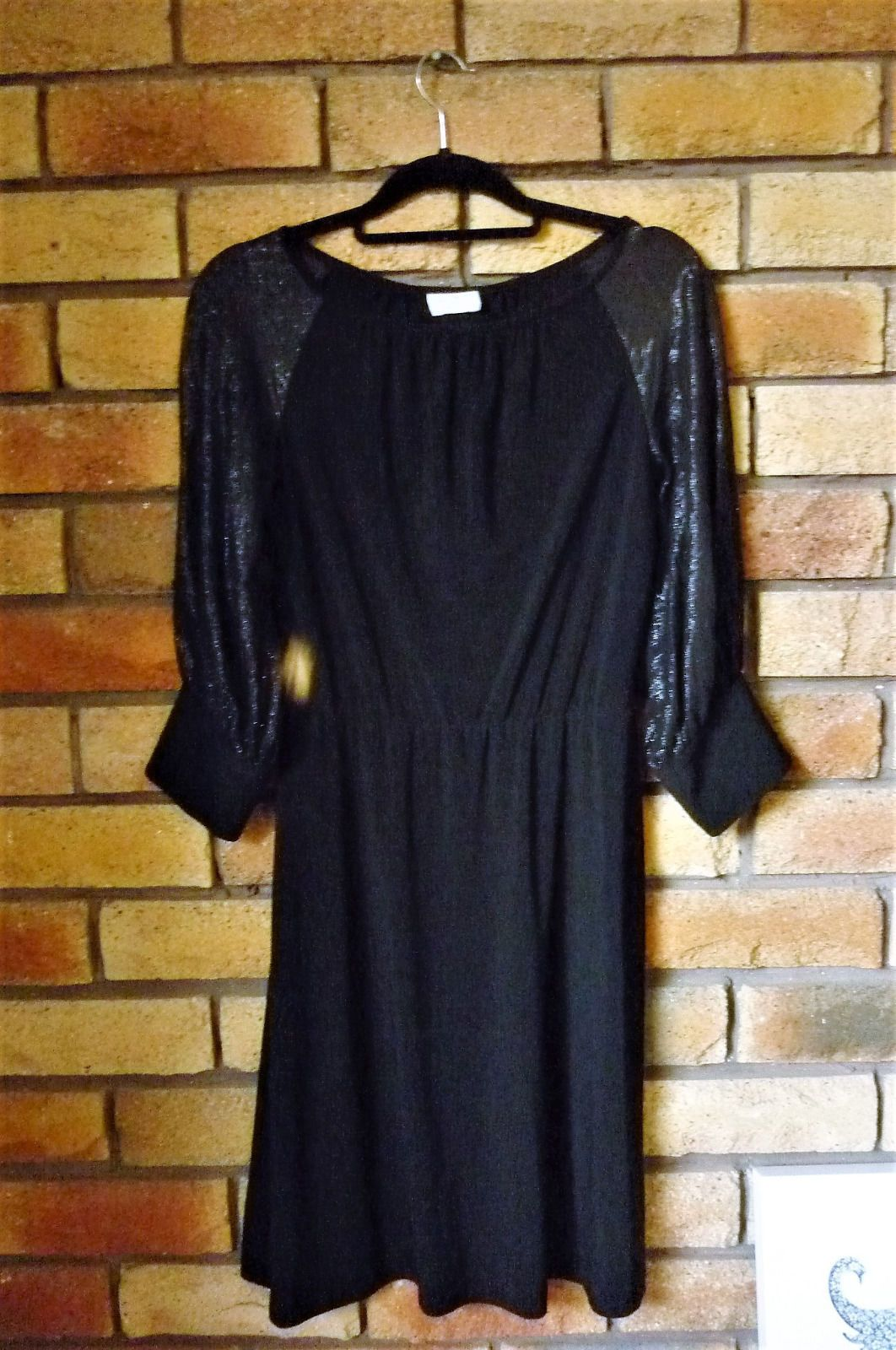 Elegant and simple black dress by leona edmiston has a wide slightly