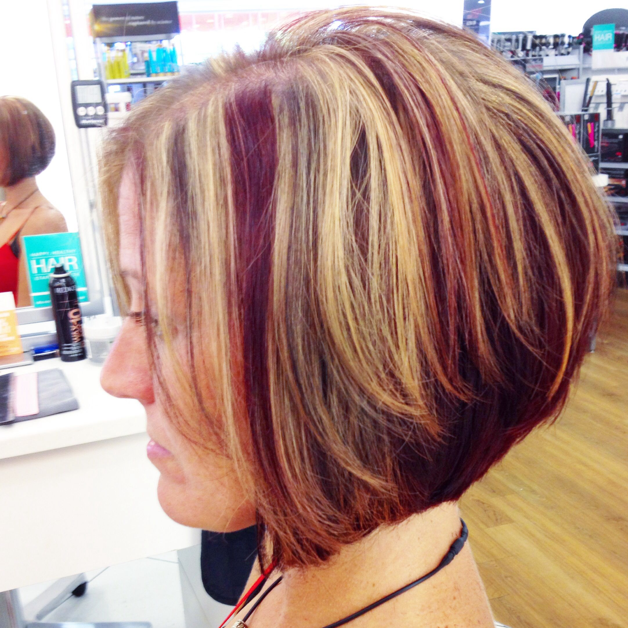 Red blonde and dark highlights and lowlights with red mahogany red blonde and dark highlights and lowlights with red mahogany underneath diagonal forward bob redken certified short hair colorsred pmusecretfo Choice Image