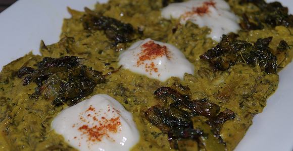 Kashke bademjan is popular as both a Persian appetizer and  a main course. Bademjan means eggplant in Persian and kashk is a kind of yogurt. In addition to eggplant and kashk, the dish also contains onion, turmeric, garlic, and dried mint. This dish is vegetarian.