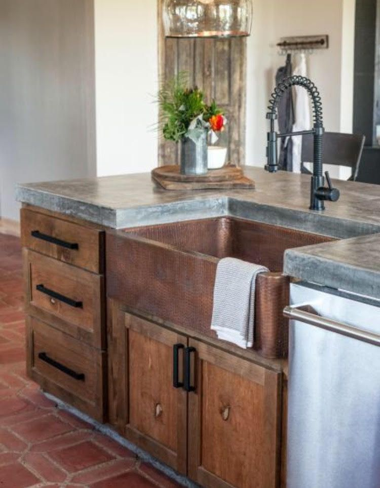 modern farmhouse style kitchen with aged copper apron front sink and