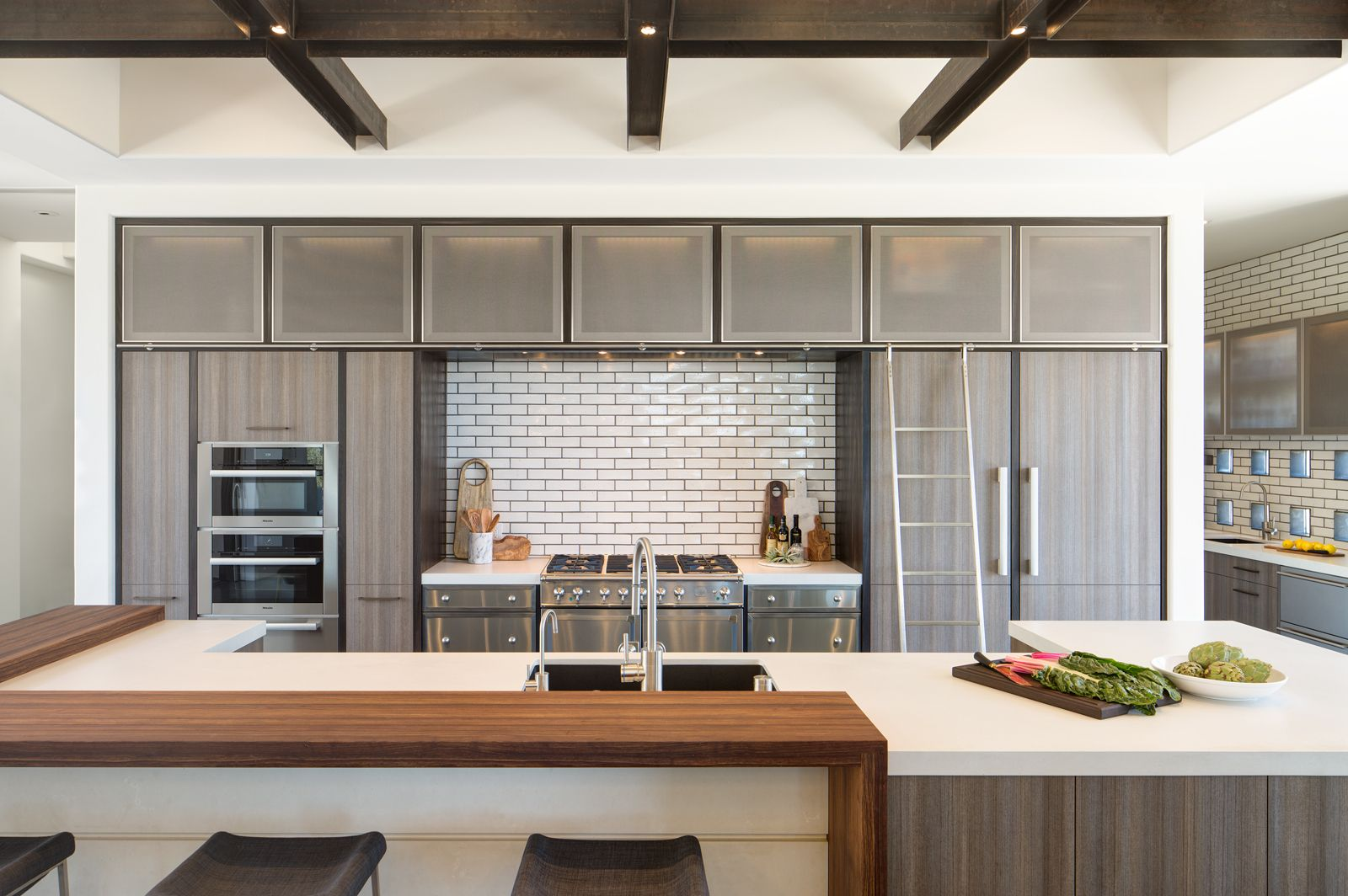 White Subway Tile In This Modern Santa Fe Kitchen By Built Design Collective Tile By Statements In Tile Brass Ac Light Kitchen Floor Kitchen Flooring Kitchen