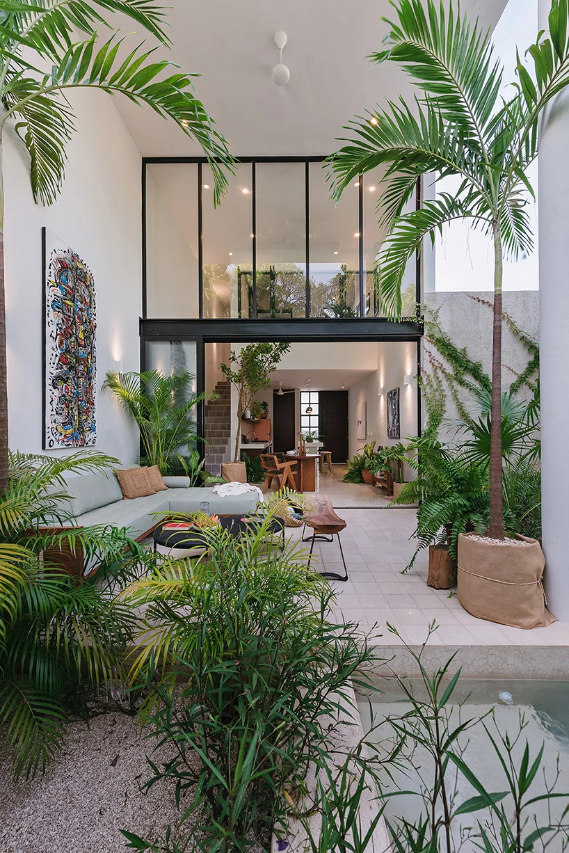 stone lattice facade clads tropical vacation house by workshop in mexico