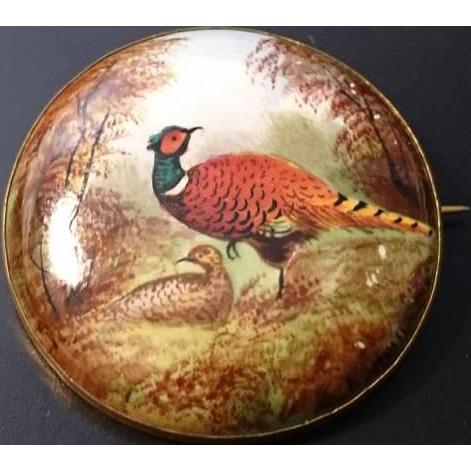 Enamelled porcelain brooch