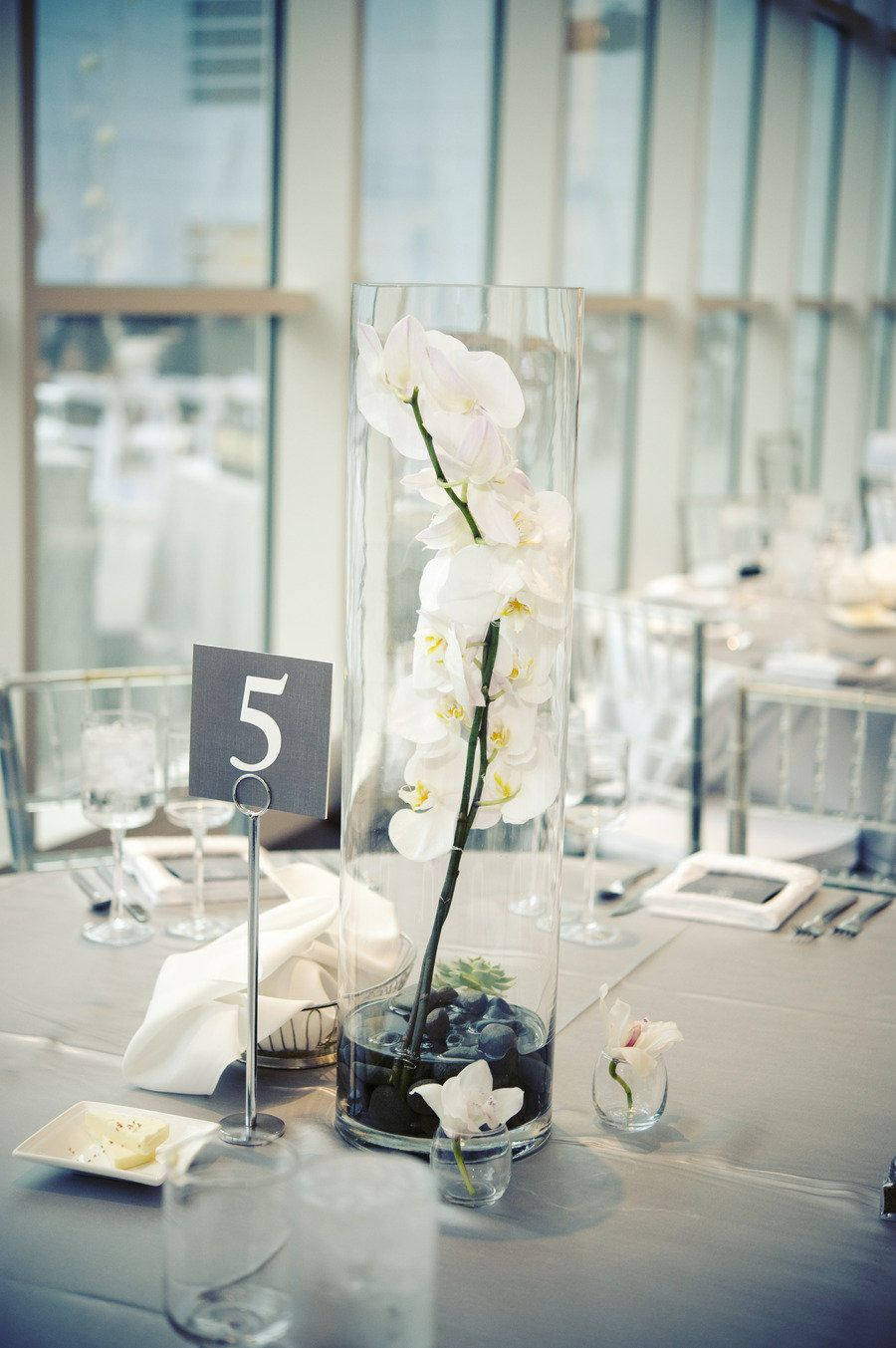 Wedding decorations yellow and gray  Orchids are always a perfect neutral and great for modern wedding