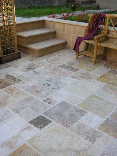 smooth concrete taped off and stained in patchwork of natural colors  diy and affordable