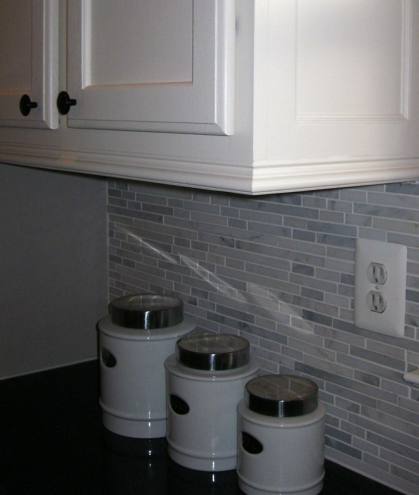 Crown Molding Added To Bottom Of Cabinets I Like This Idea Perfect To Hide Strips Of Light For U Kitchen Cabinet Molding New Kitchen Cabinets Cabinet Molding
