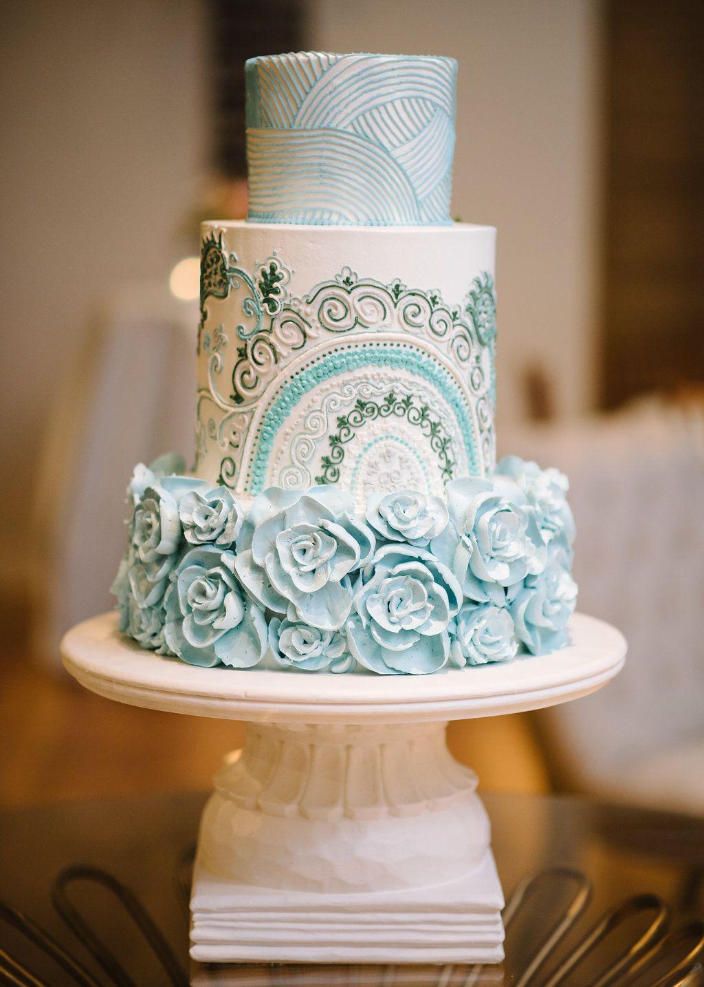The intricately detailed bluehued wedding cake soft hues u ocean