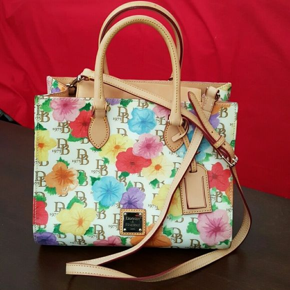 """Dooney Bourke Satchel with Arm and Shoulder Strap 9"""" height 11"""" width, body-49% cotton, 24% PVC, 27% resins, trim 100% leather. Multi color flowers. Dooney & Bourke Bags Satchels"""