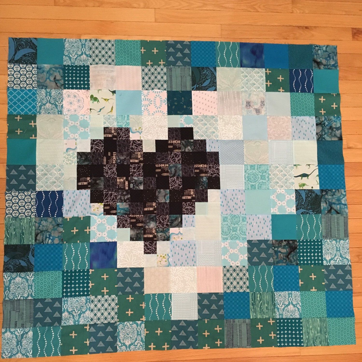 A custom Pixel Heart quilt that I am loving!