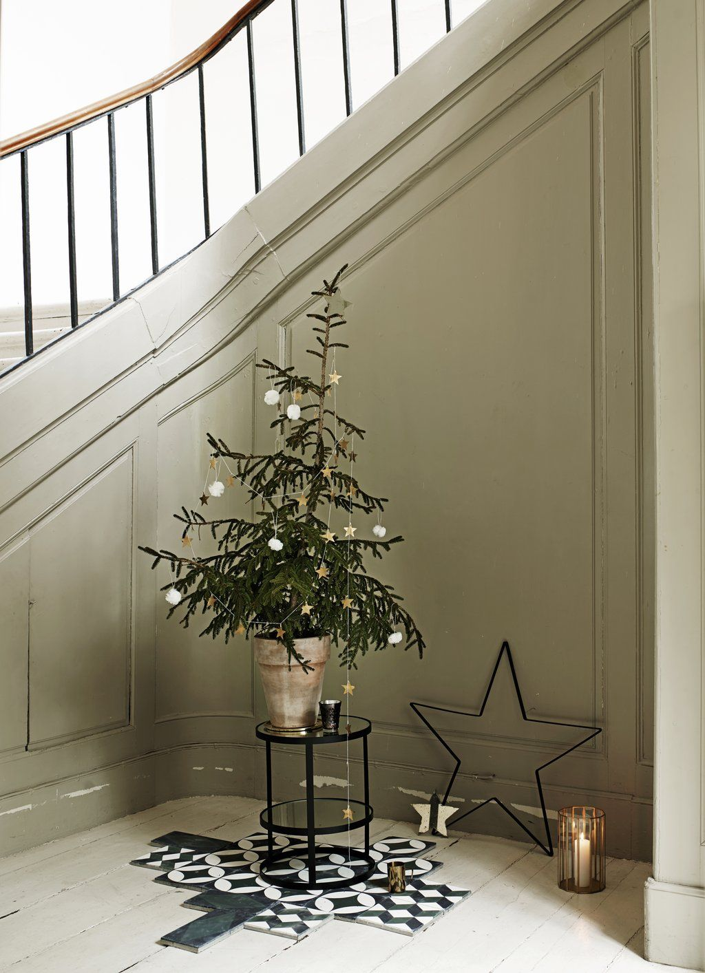 Add the christmas feeling by decorating with trees and stars from tinekhome.