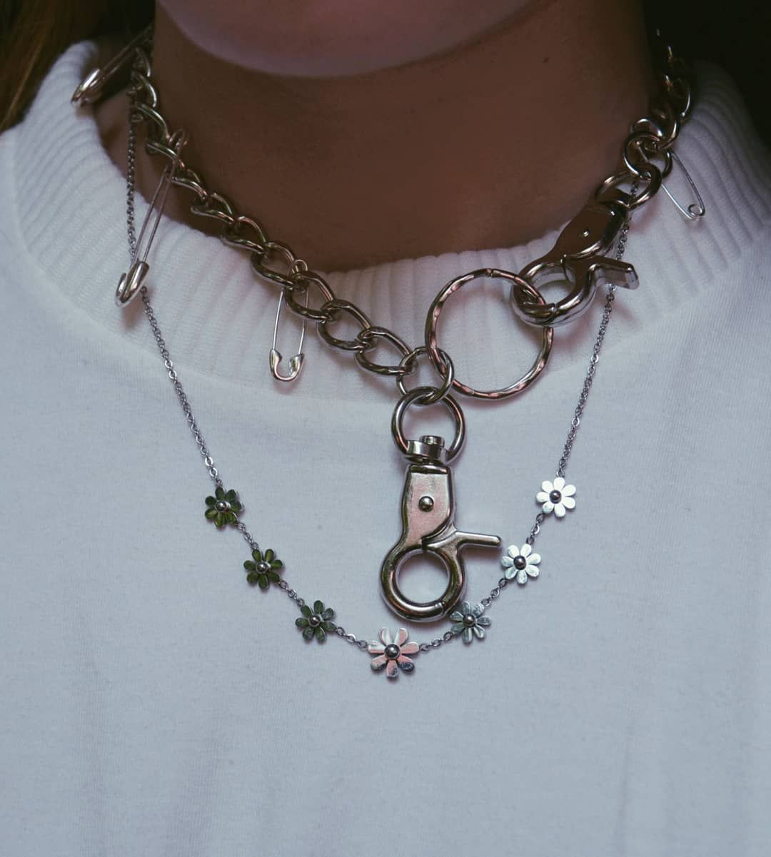 Silver chain necklace with flowers and safety pins