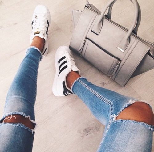 Image via We Heart It #adidas #bag #bed #black #blackandwhite #blue #handbag #jeans #legs #ripped #rippedjeans #tumblr #vogue #white #superstar #love