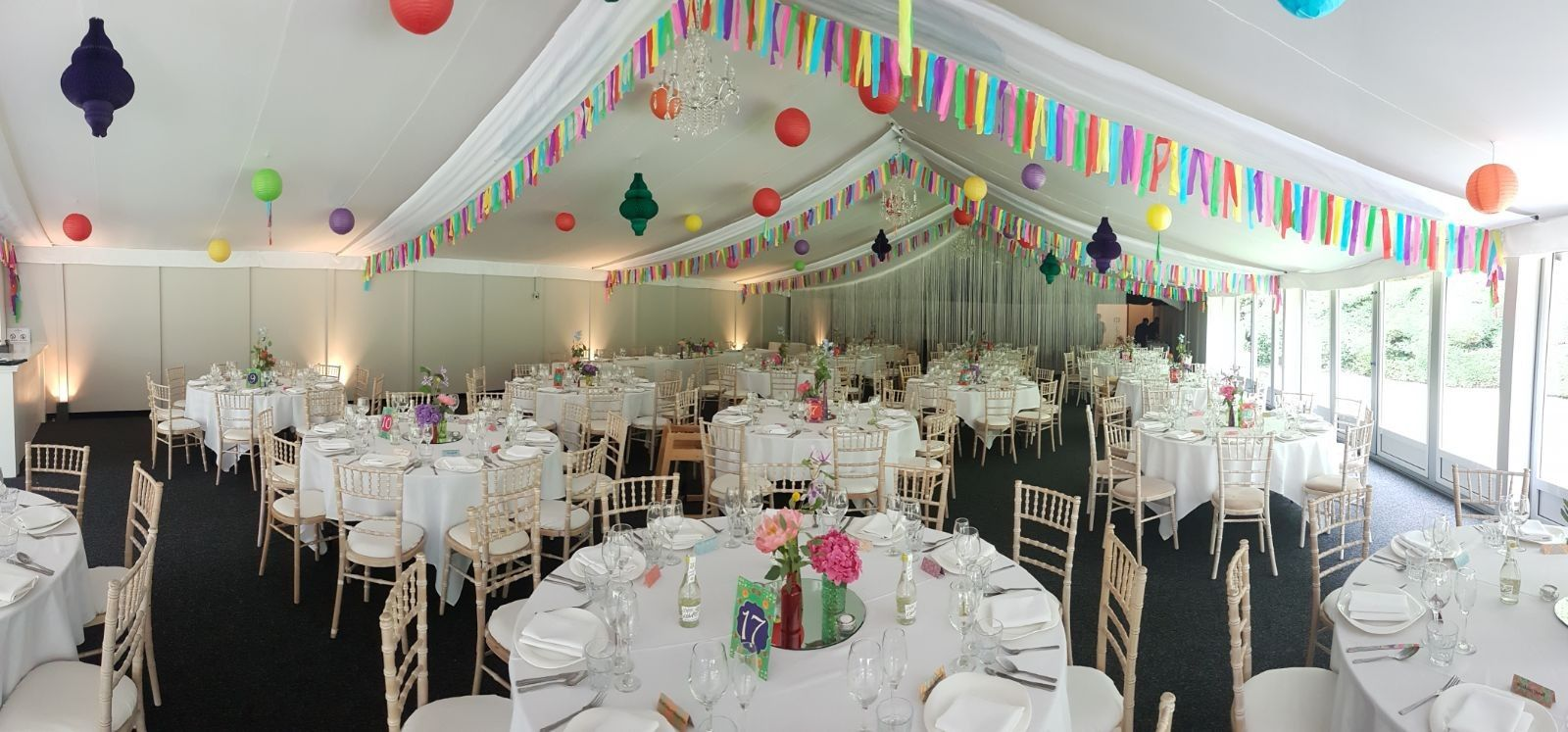 Paper lanterns wedding decoration ideas  Colourfull streamers as bunting hanging paper lanterns flowers in