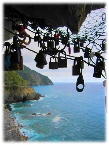 Via Dell'Amore, The Road of Love, where Cinque Terre Wedding couples lock their love locks to the seaside railing to lock their love forever. By Cinque Terre Wedding.