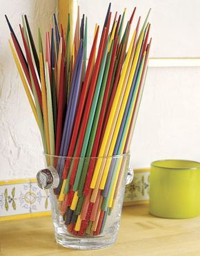 Artfully displayed colorful chopsticks are an unexpected but fun addition to your dining room. - CountryLiving.com