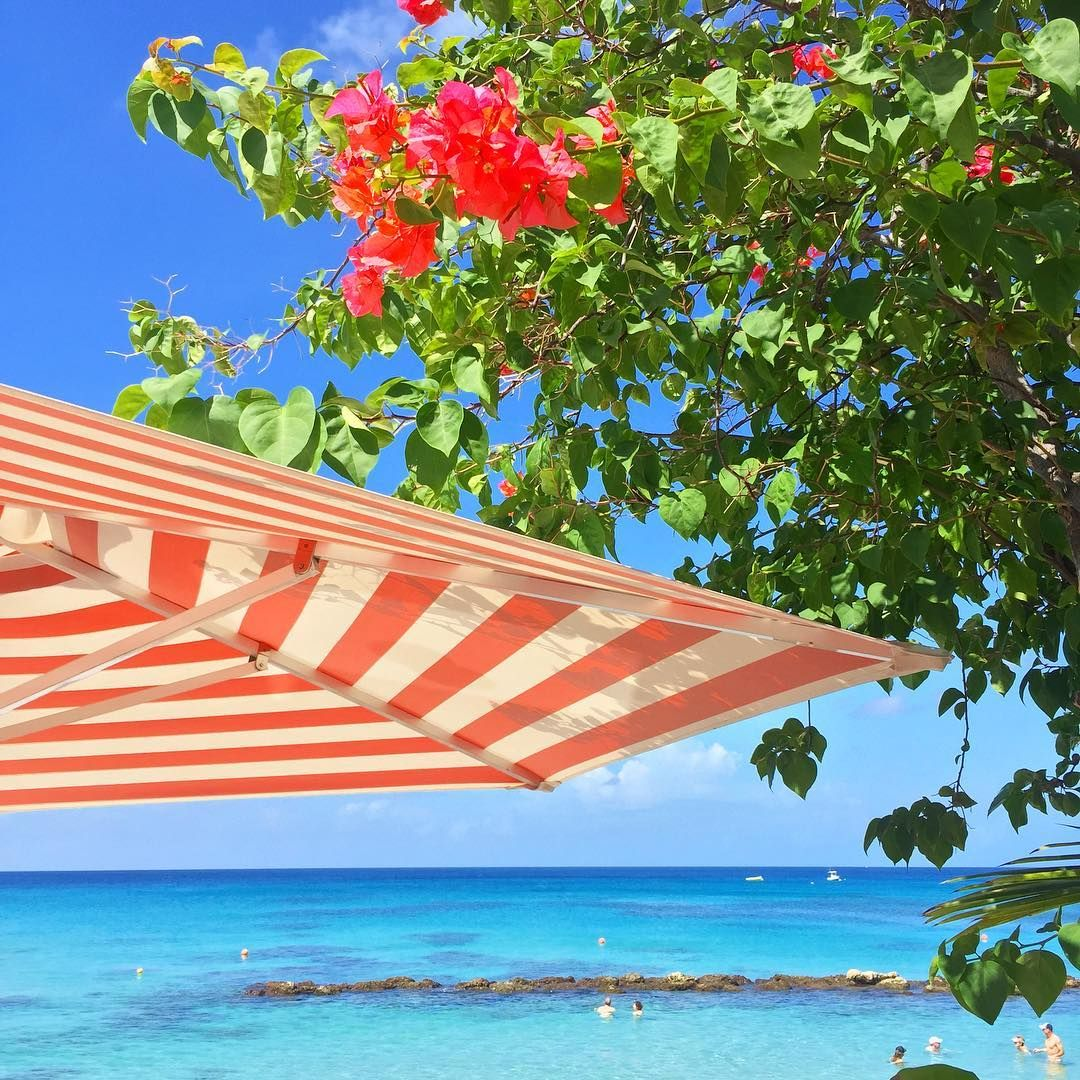 Our Iconic striped umbrellas at Cobblers Cove.   #cobblerscove #lovebarbados #barbados