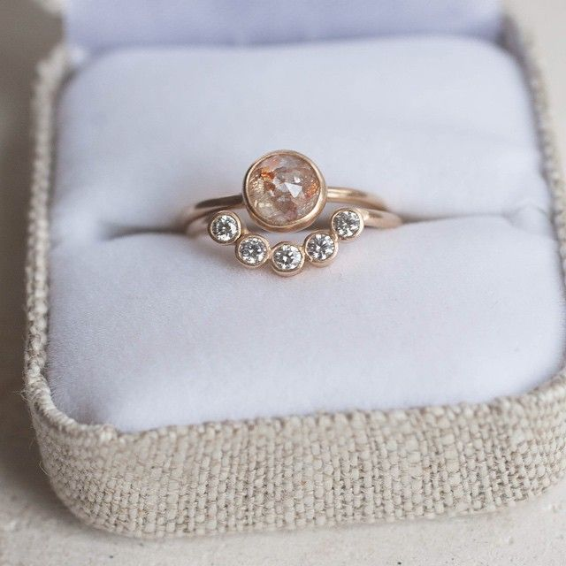 Love this gorgeous diamond solitaire with flecks of peach and red with our diamond curve band!