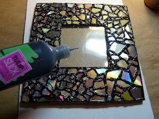 DIY - Recycled CD Mosaic Photo Frame. I cant believe I just threw away my old CDs.