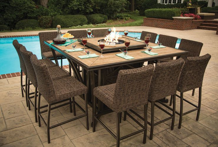 The Franklin High Dining Set From Agio Can Seat Up To 12 People Table With Fire Has A Porcelain Tile Tabletop Wood Grain Pattern
