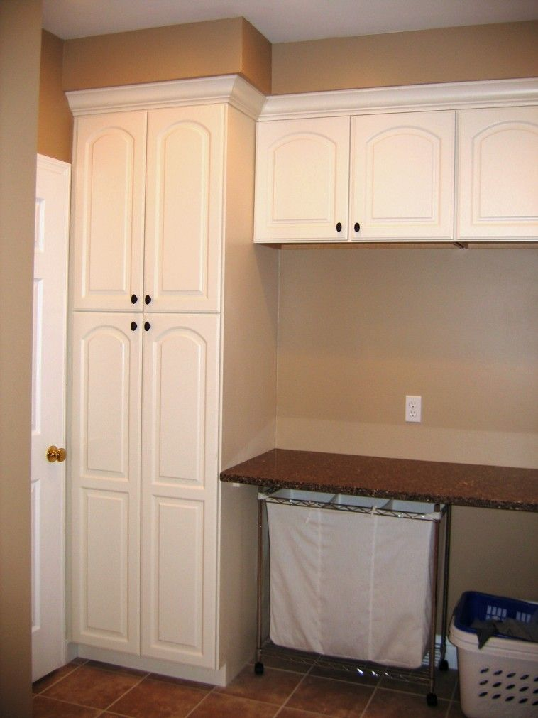 Charmant Closet And Folding Table With Iron Frame Hampers Below On Brown Floor As  Well As Utility Room Storage Cabinets Plus Best Laundry Room Design