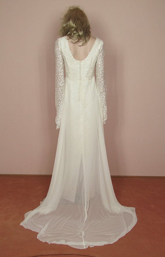 Empire style dress Tube dress with sheer chiffon panel overlaid Long sheer sleeves Square neckline in front and rounded neckline in the back