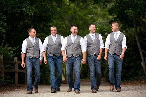 Groomsmen In Vests And Jeans For A Rustic Wedding