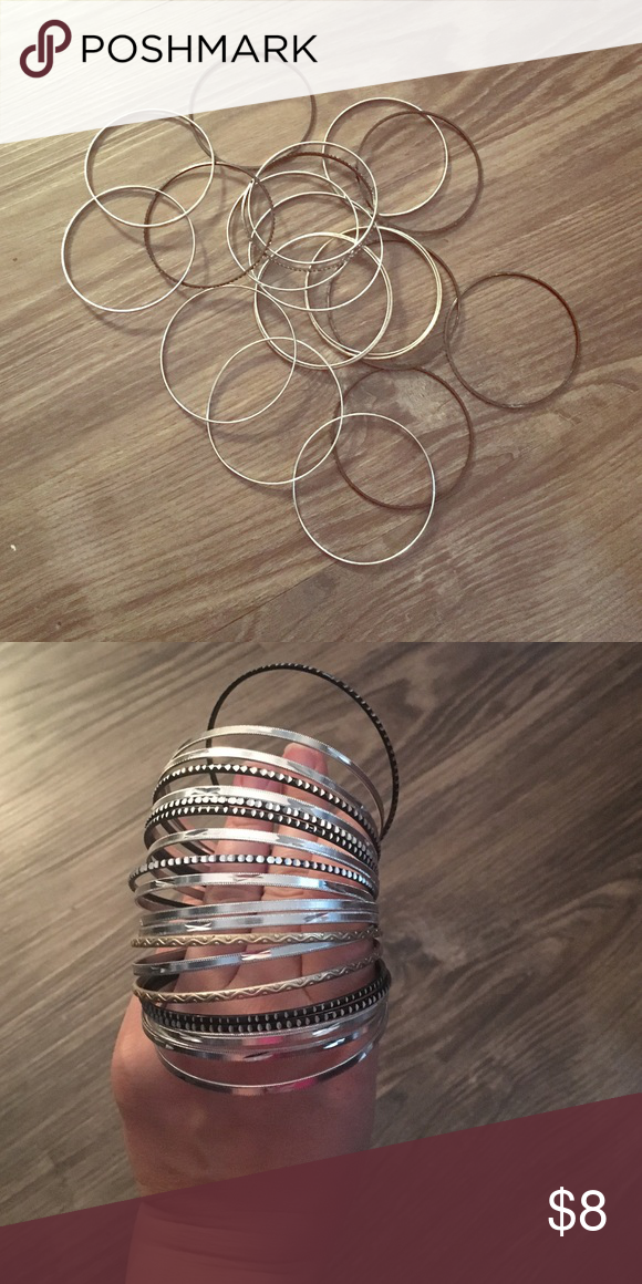 BANGLES Mixture of black, silver, and light gold bangles Jewelry Bracelets