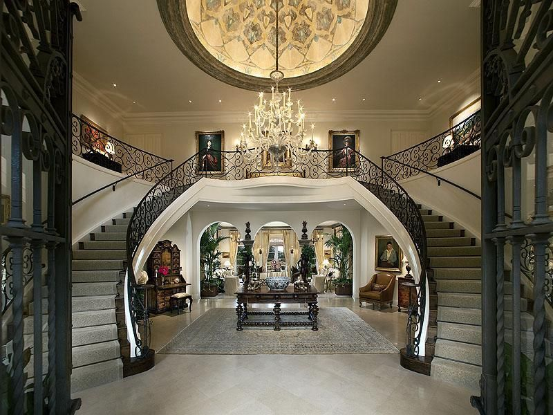 Grand entryway with double staircase dream entry for House plans with stairs in foyer