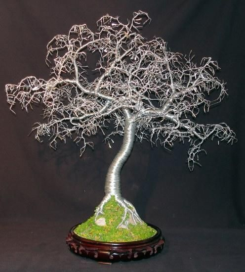 saw a man making and selling wire trees like these on the street ...