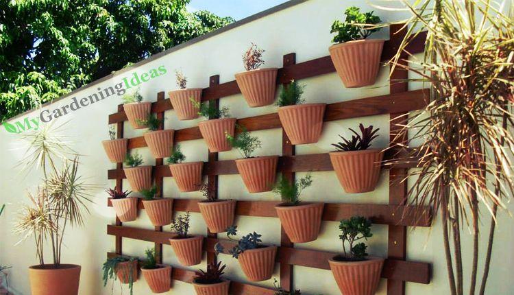 Hanging pots against a wooden frame
