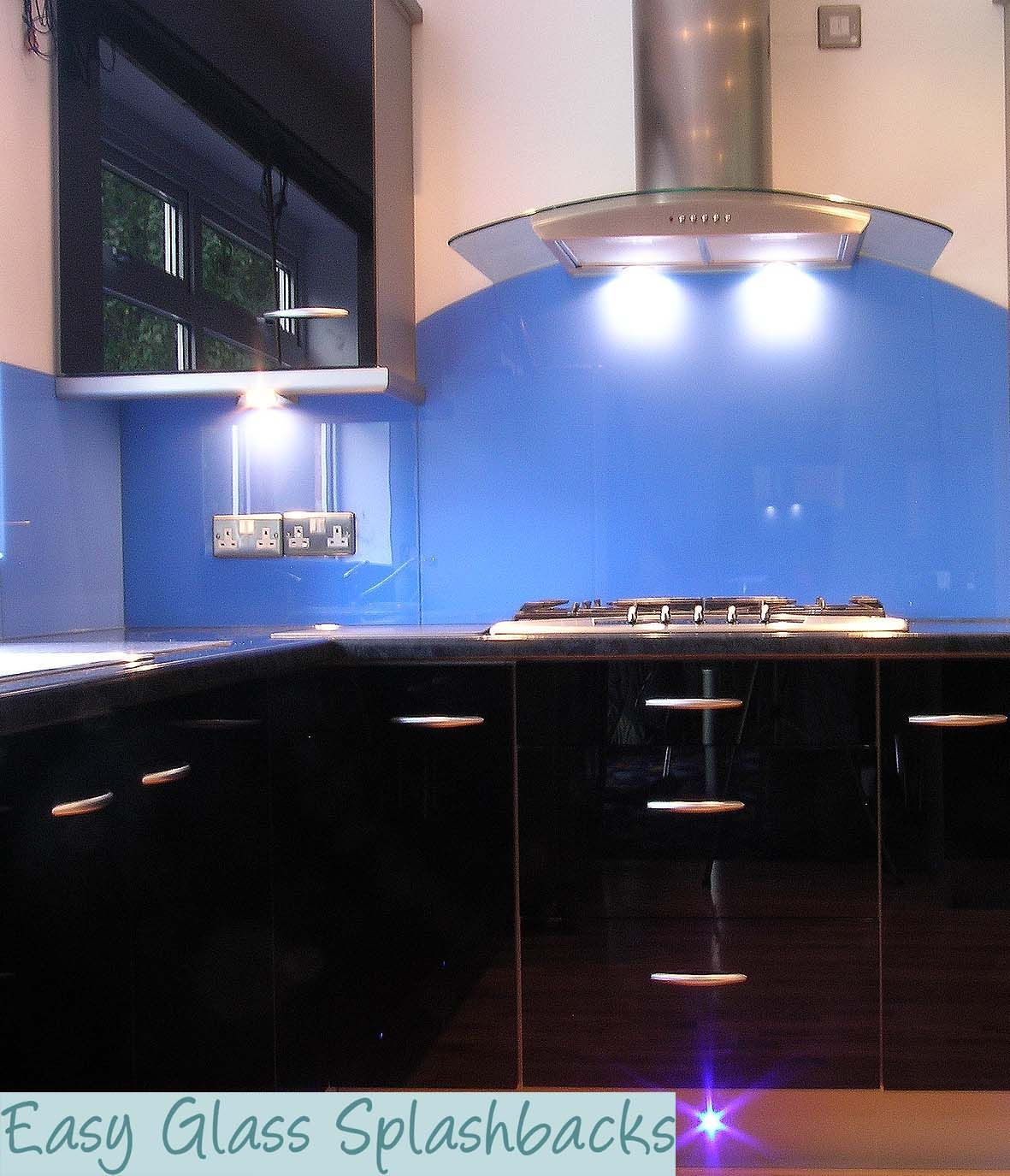 Royal Blue Coloured Glass Splashback In A White Kitchen With Worktop Visit Easyglasssplashbackscouk To Discover More