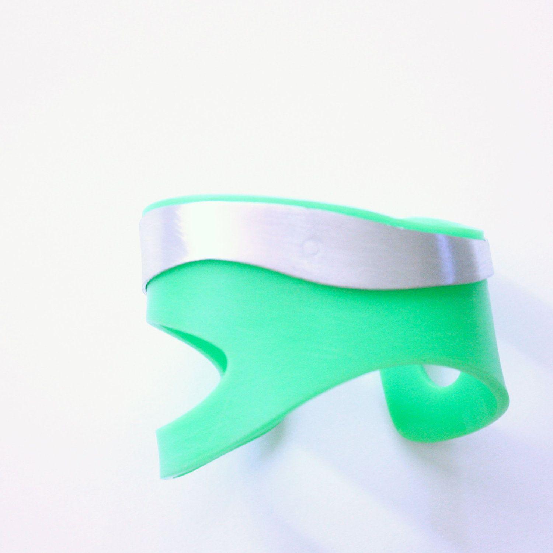 Abstract green and silver cuff- Green acrylic and aluminium. €114,00, via Etsy.